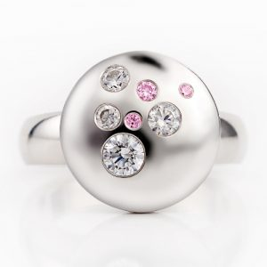 diamond and pink stone ring designed by Sarah May