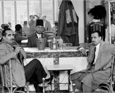Men sitting in Cafe in Tripoli - Marilyn Stafford, Photojournalist