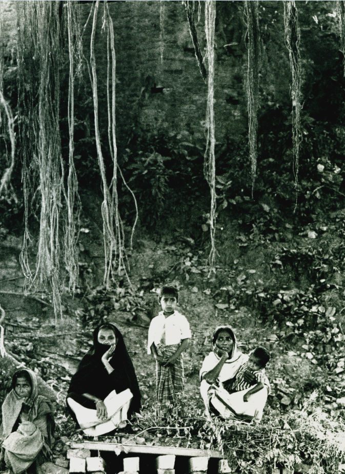Refugees sitting in a forest - Marilyn Stafford