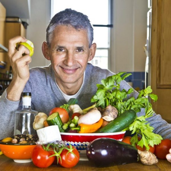 Tim Spector with a table full of vegetables